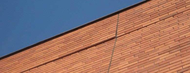 bowed brick wall